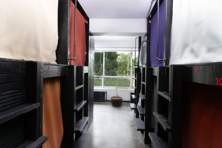 You will have one of the single beds in the shared room. Room has an A/C with shared bathroom at the same floor.
