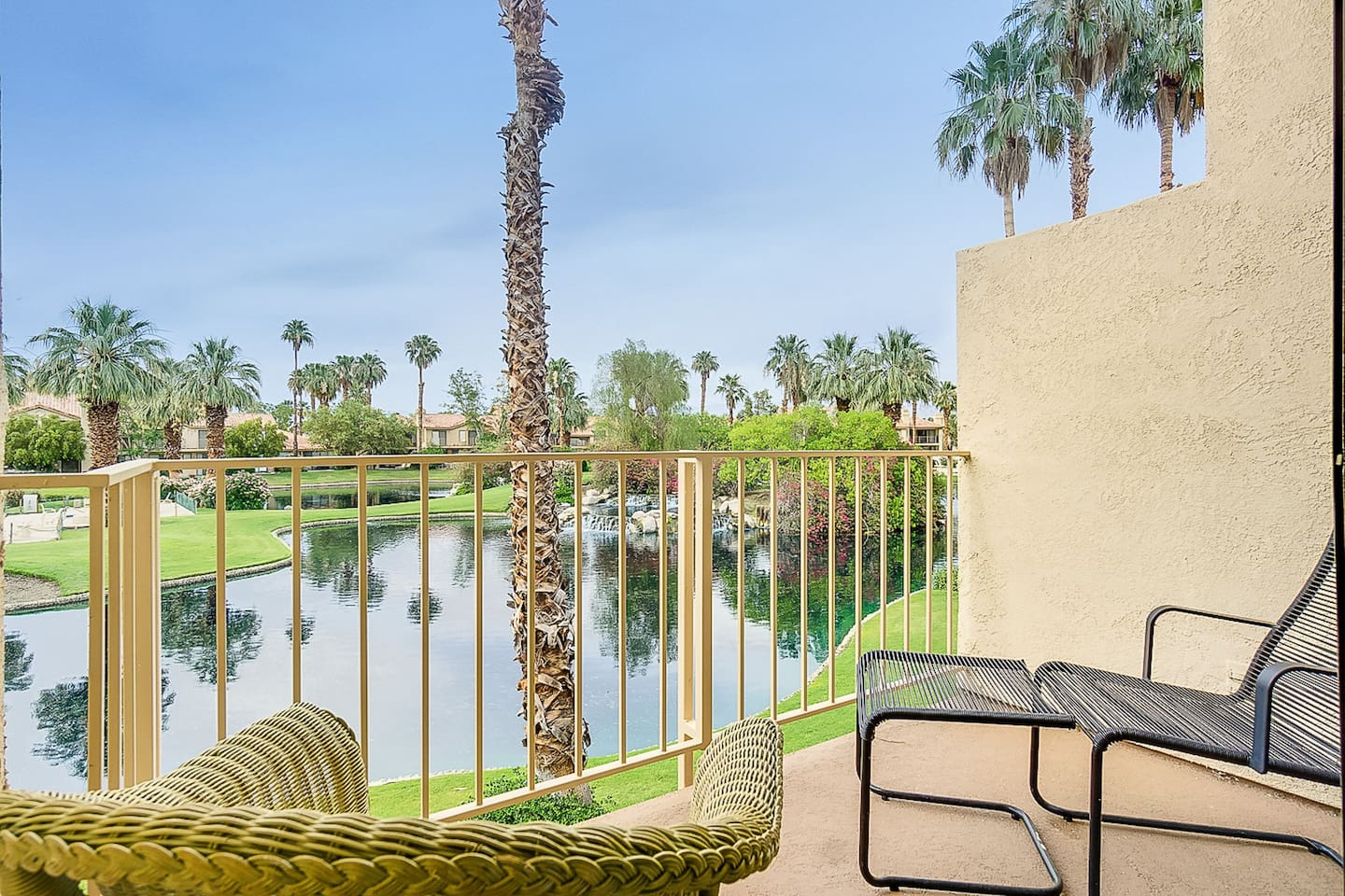 Welcome to Palm Springs! Relax on the balcony with your morning coffee.