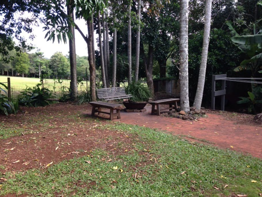 Great back garden for children to play - a fire pit, sand pit, tree house, vegetable garden and mango tree