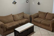 Living room area, complete with queen sleeper sofa and loveseat-plenty of extra space!