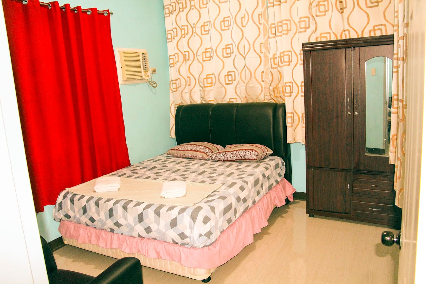 The AC master bedroom has queen size bed with blankets/towels with your own personal cabinet and side corner table...