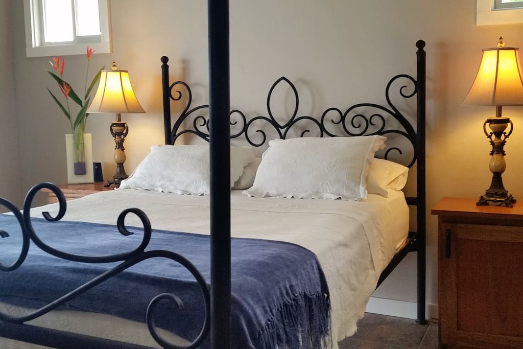 The ocean bedroom - with hand forged wrought iron 4 poster bed and pillow top mattress