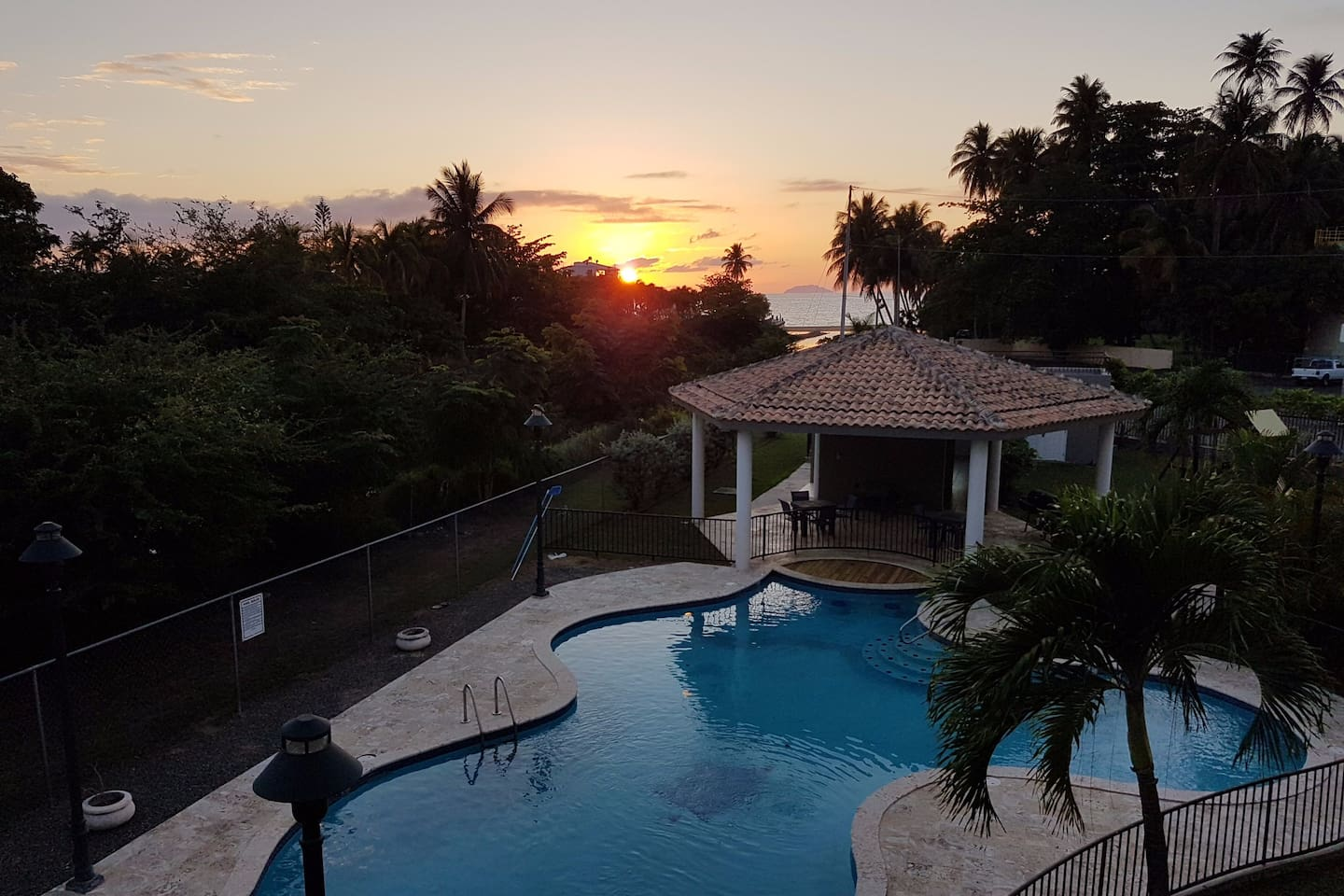 Watch the beautiful sunset from your balcony!  The apartment faces west overlooking the pool, a canal that leads to the ocean, and Desecheo Island off in the distance.