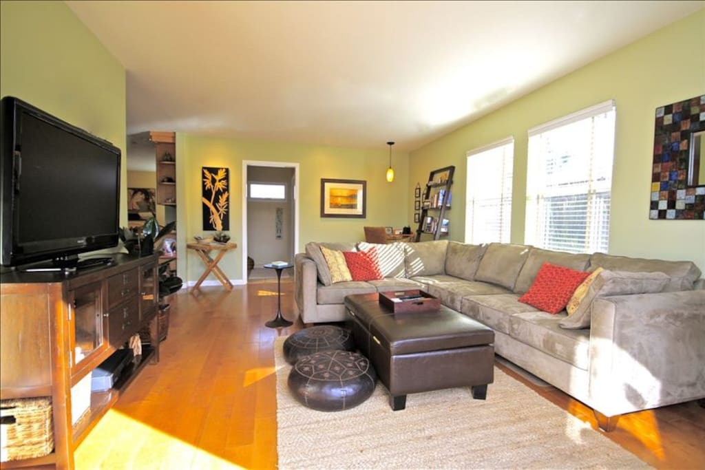 Oversized great room has large flat-screen TV, over 100 DVDs, and CD collection.