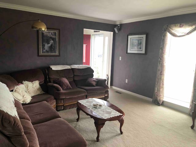Living room with comfy sectional and TV for your use