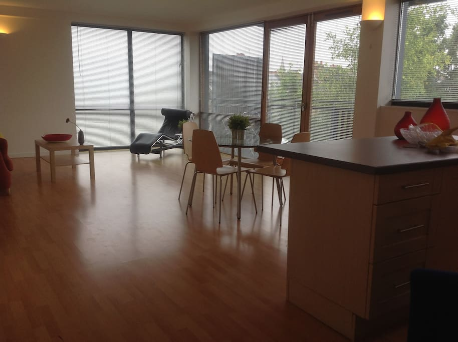Spacious lounge with huge windows leads onto balcony