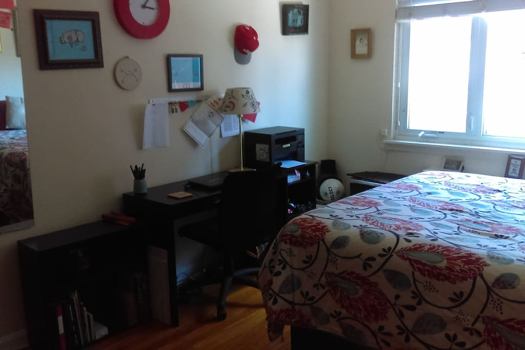 Different angle of bedroom #1.  There's a desk for workin' and a printer for printin'.