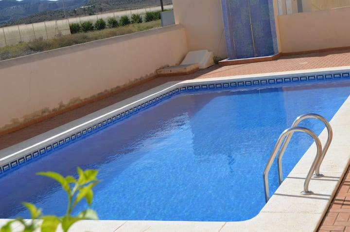 Ground floor apartment, large patio, communal pool