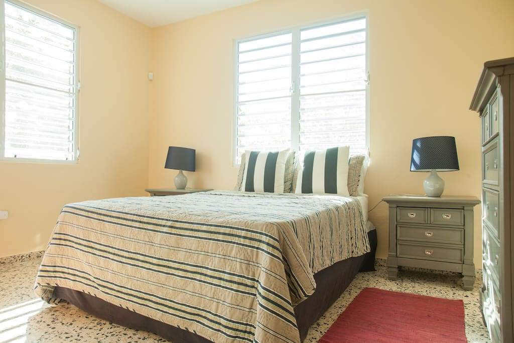 Master bedroom suite flooded with natural light and cool breezes