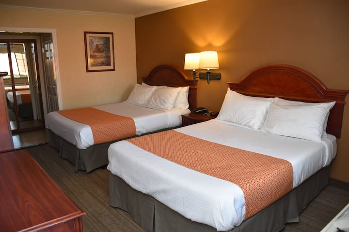 Deluxe Room with Two Queen Beds. All rooms are independent from each other with exterior corridor. Only accepting reservations  for essential travelers or if you have no place to stay.