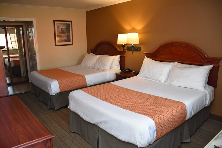 Deluxe Room with Two Queen Beds and Hot Breakfast included (to go). All rooms are independent from each other with exterior corridor.