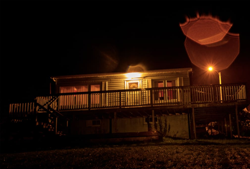 Front of the cottage at night