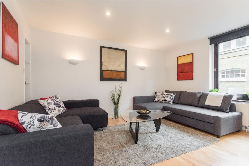 Large lounge with comfortable furniture, large windows, and view into Covent Garden