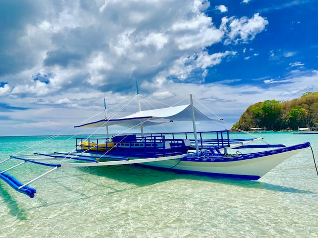 This is our 48 foot large party boat.  Now ready to sail. Explore some untouched and undiscovered north el nido islands. Exclusive for our guests only. Photo taken just front of Fisherman's Cottage.