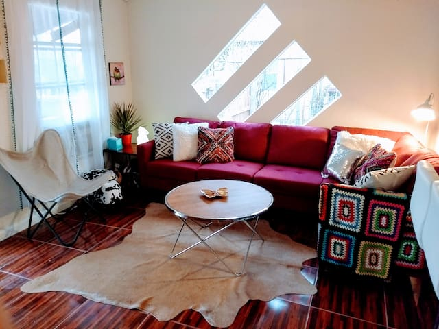 """Living Room is bright with plenty of comfortable seating for the whole family. Couch is the """"bed"""" (or airbed/ playpen) for groups of more than 4."""