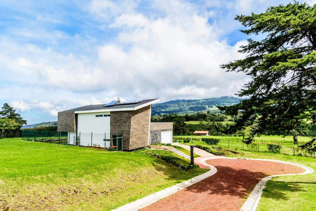 Entrace to this spectacular design house viewing to the mountains towards Poas Volcano