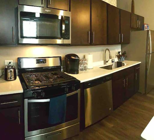 Fully equipped, stainless steel kitchen with all utensils and supplies.