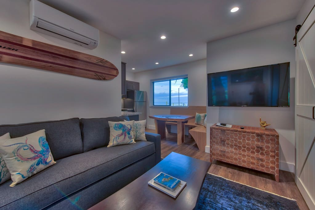 Living room with full size pullout couch that sleeps 2