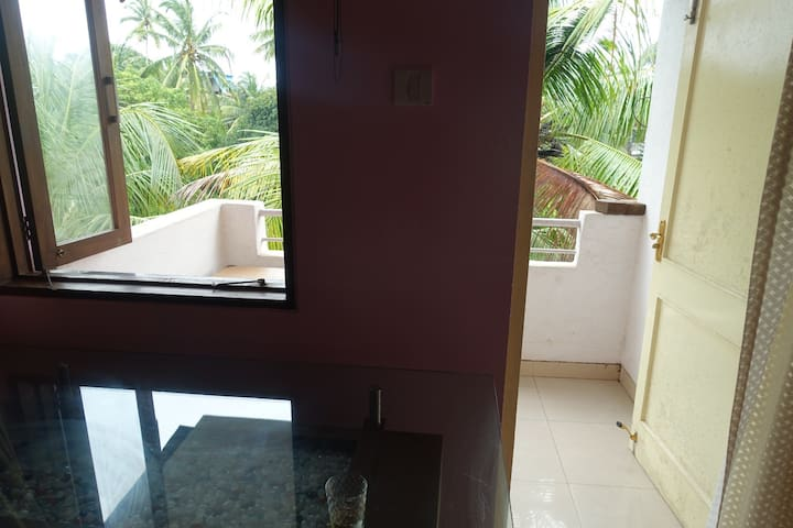 Entrance from sitting room to first balcony.
