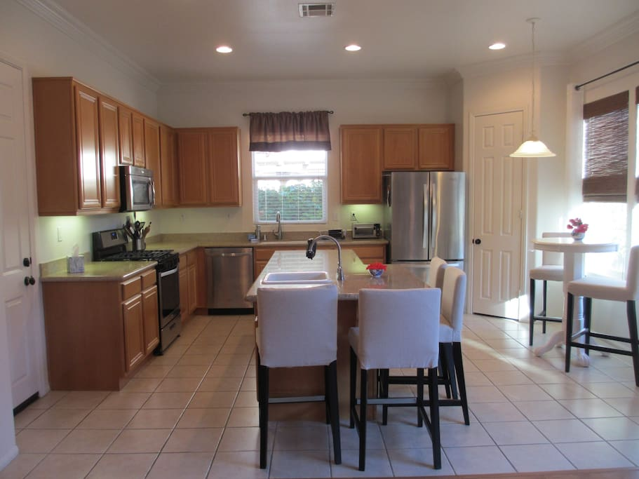 The bright kitchen is fully equipped with comfy seating.