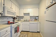 Utilize the appliances featured in the fully equipped kitchen.