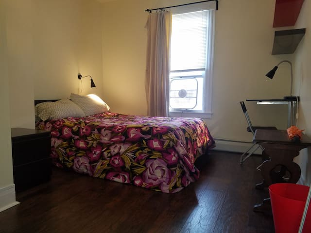 Lilly Pad Ivy Room with comfortable Full Bed and hardwood floors.