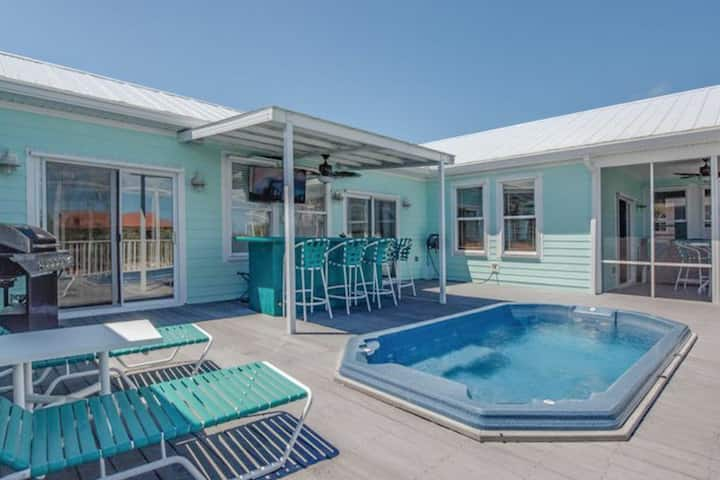 New listing! Canal front home with dock, quick ocean access and a hot tub!
