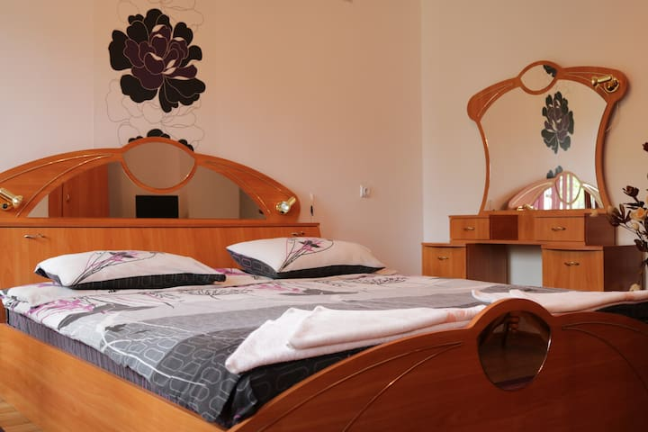 Spacious room with double bed and sofa