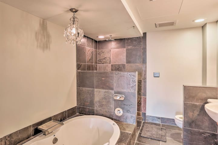 Rinse off in the walk-in shower or soak in the jetted bathtub.