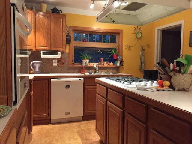 Large eat in kitchen with huge Island  stove. Make meals for the whole family or check out one of the many restaurants within walking distance.