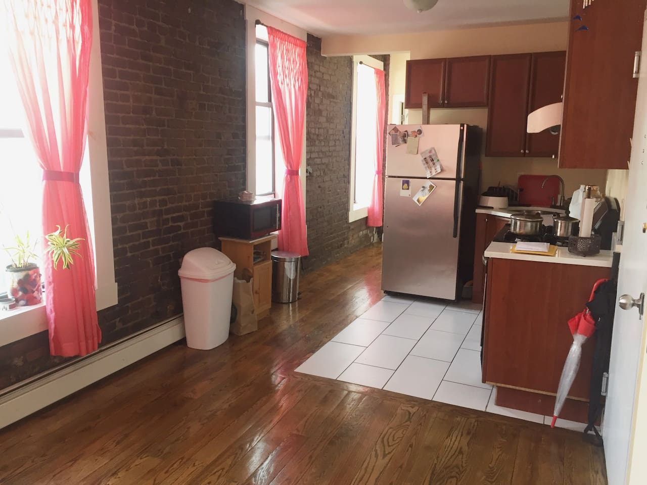 Beautiful exposed brick and lots of space in the common living area.  Windows offer a beautiful view of Harlem.  If you're here during the NYC Marathon, the runners run right in front of these windows!!