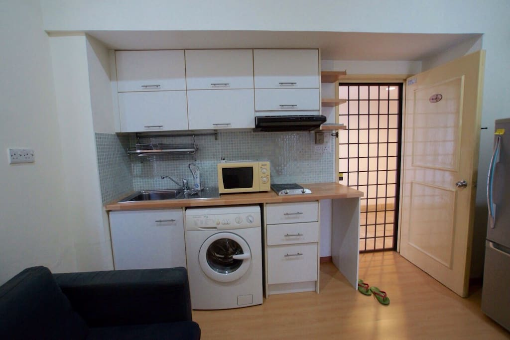Small kitchen with basic appliances for light cooking.