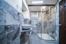 - Brand new marble shower room