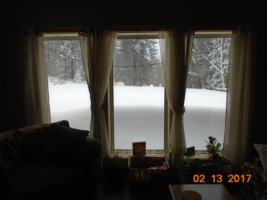3 large living room windows to sit and relax and watch the snow pile up!
