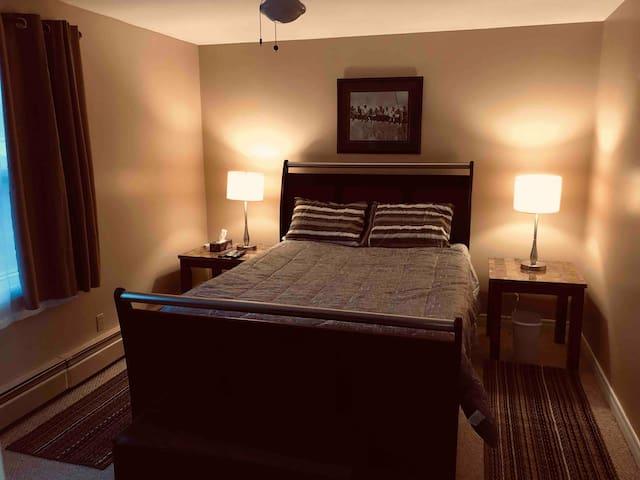 Captain's Bedroom  with Queen Bed and en-suite bathroom.