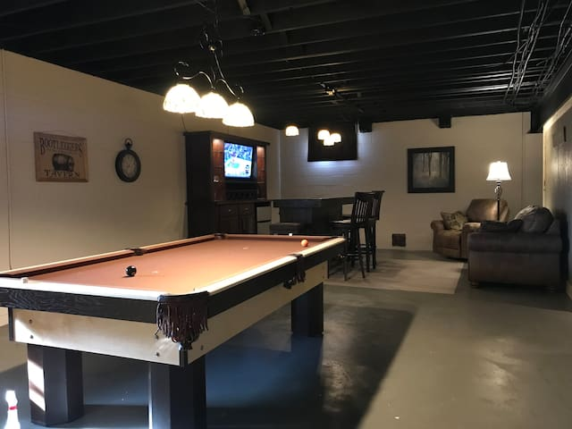 Pool table and bar in basement