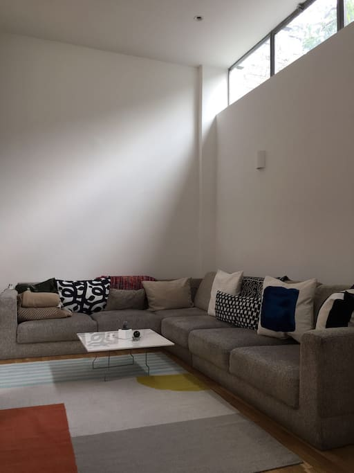 Large living space and comfy couch - beautiful refurbished warehouse in east London