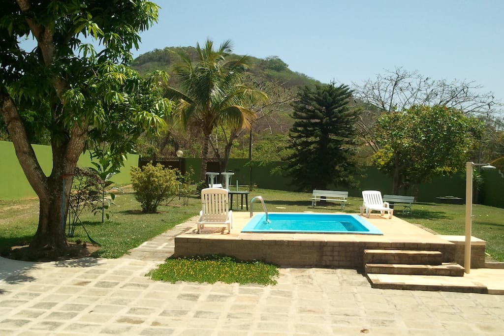 The guests have easy access to the swimming pool, garden and varanda, to have fun and relax.