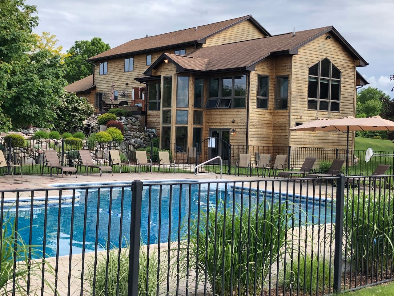 Heated pool with diving board, jacuzzi seats, turbo slide, underwater lights, child proof gate. Seating for twenty, shallow area roped off for non swimmers. Deep end 10' for safe diving board use. Pool area lite for night swimming.