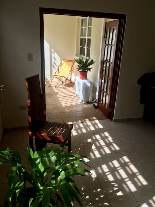 Balcony located next to living area near entrance of the apartment.