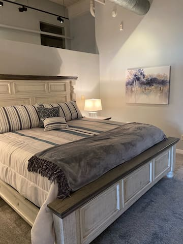 "King bedroom with 50"" Smart TV"