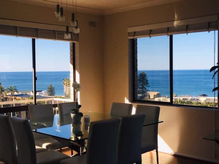 Ocean and headland views in sunny beach apartment