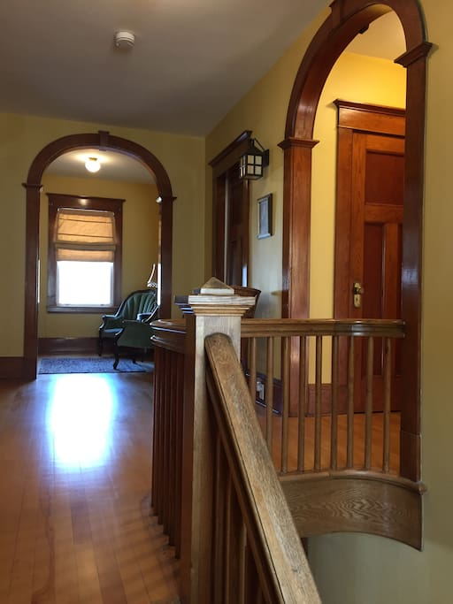 Home features original craftsmanship. Reading area in the alcove.