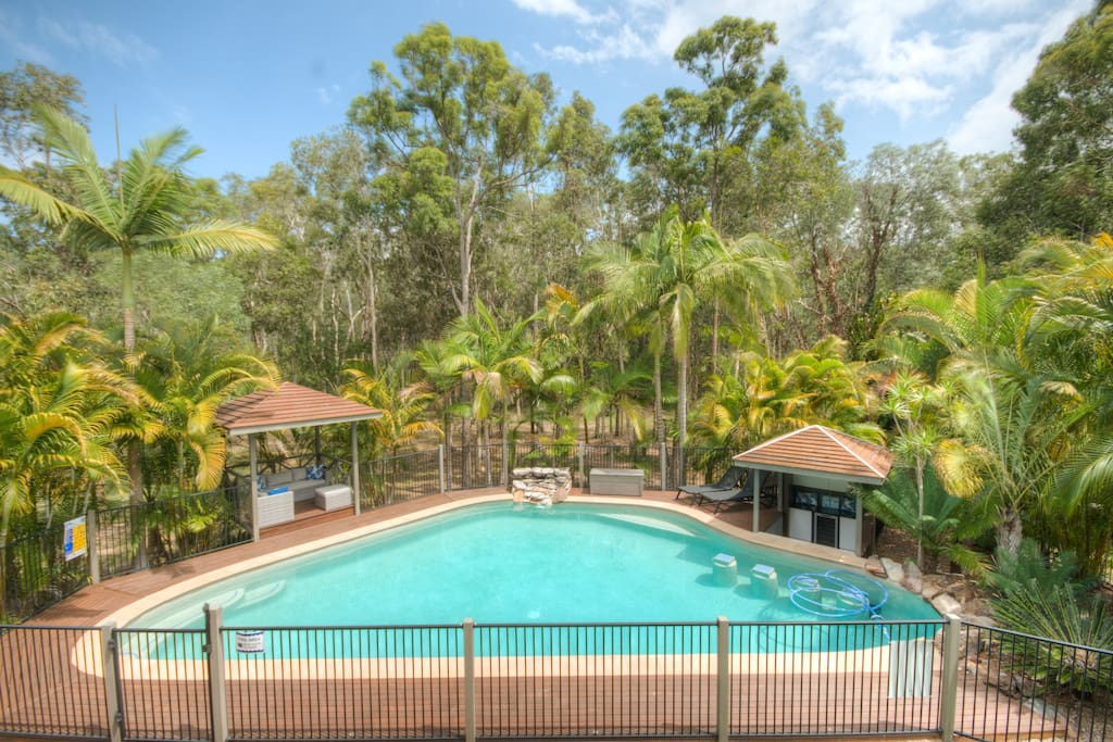 Noosa Gums boasts a sun-drenched 100,000L pool with swim up bar & day bed gazebo