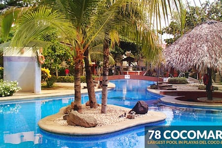 2BDR condo, safe/clean/secure 5 mins walk to beach - Coco - Selveierleilighet