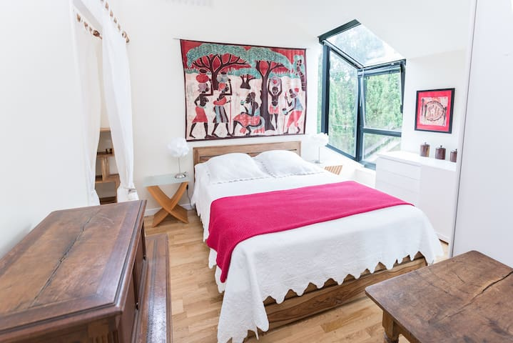 Master bedroom with ensuite and a queen bed
