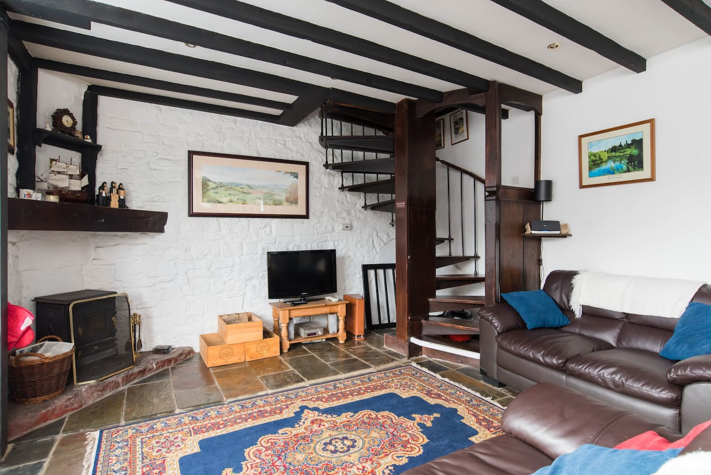 Lounge ( showing spiral staircase to upstairs)