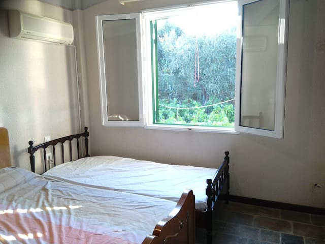 Here we have the 2nd bedroom and the view of its window.