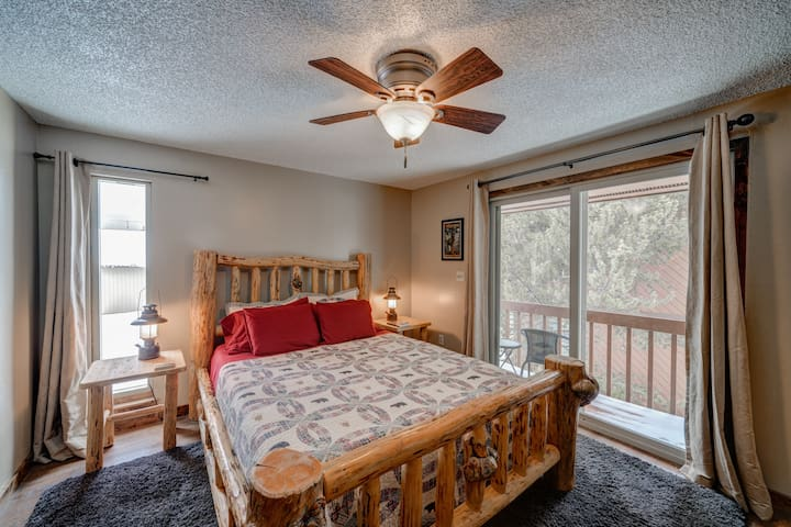 """The spacious and comfortable master bedroom features a queen-sized bed and small balcony. """"Our rooms looked just like the pictures- clean and cozy."""" - Jenny"""