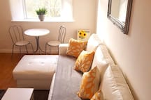 The front room sofa turns into a double bed and there's plenty of duvets, throws and extra pillows housed inside.